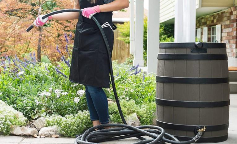 Using rain barrel to water garden