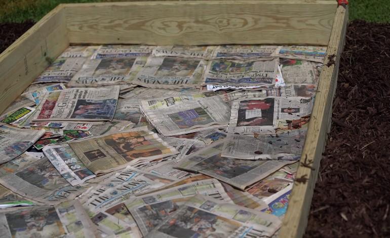 Using newspaper in bottom of raised garden bed